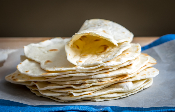 These light, delicious homemade flour tortillas have only four ingredients and come in at just under eight cents each. mexicanplease.com