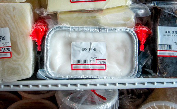 pork lard in butchers freezer blurred