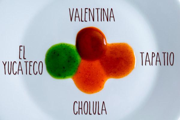 four mexican hot sauce closeup viscosity