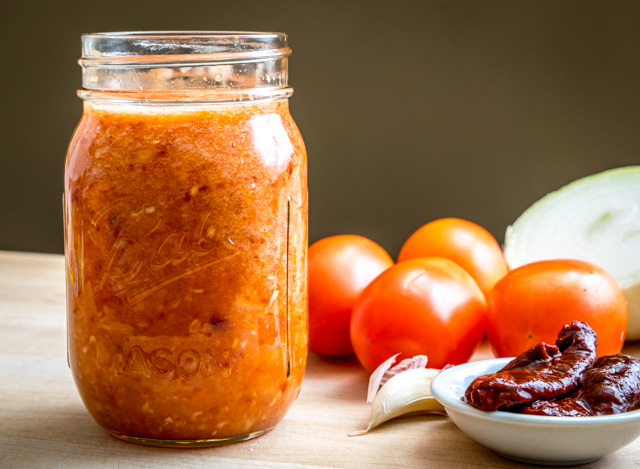 This Tomato Chipotle Salsa has a rich, smoky flavor from the delightful chipotles in adobo. And if you roast the tomatoes you end up with a warm, authentic salsa -- so good! mexicanplease.com
