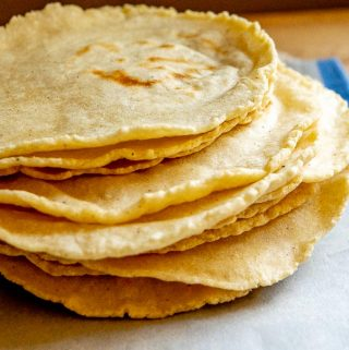 14 corn tortillas after cooking on comal
