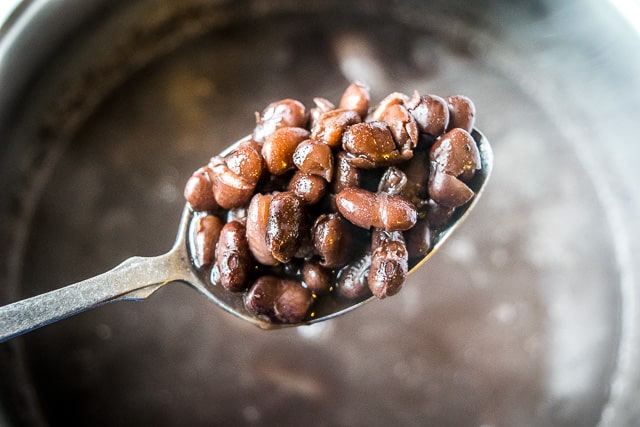 It's surprising how easy it is to make a batch of authentic Mexican pot beans. These Frijoles de Olla not only taste better than storebought beans, they're also very kind to your wallet! mexicanplease.com