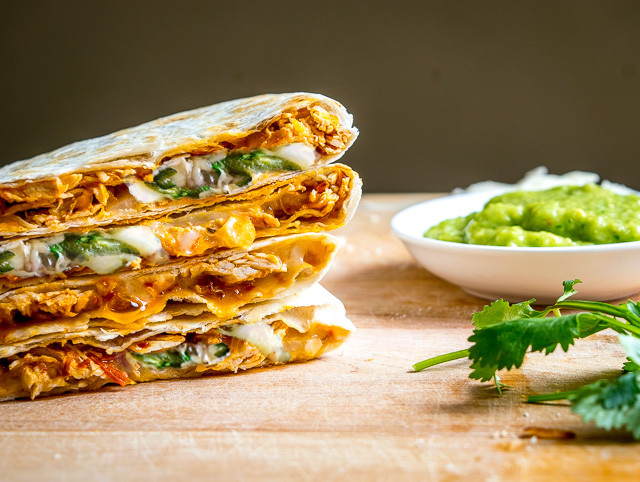 Got leftover Tinga? Make Tingadillas! These Cheesy Chicken Tinga Quesadillas with Green Sauce will change the course of your day for the better -- also includes recipe for making Tinga from scratch | mexicanplease.com