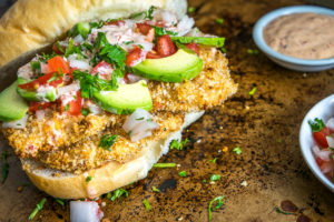 This Baked Milanesa Torta is loaded with avocado, Pico de Gallo and chipotle mayo. Yowsa! No frying either, just bread the chicken cutlets and give 'em 12 minutes in the oven. Buen Provecho. mexicanplease.com