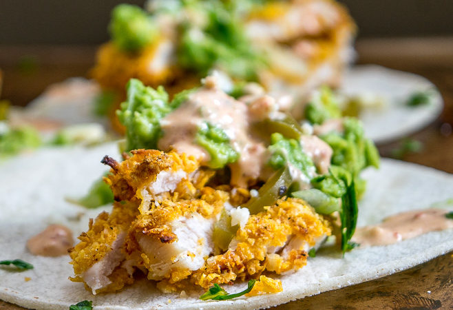 I've been eating these Crispy Chicken Tacos all week long -- crispy chicken strips, chipotle crema, guacamole, pickled jalapenos, Cotija cheese and cilantro -- all served on a warm corn tortilla. So good! mexicanplease.com