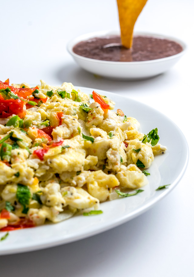 These Mexican Scrambled Eggs are perfect for lazy weekend mornings: well-balanced, easy to make, and they have real kick. Try draining the tomatoes before adding them to the pan, so much better! mexicanplease.com