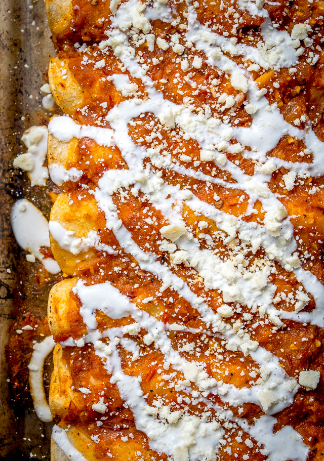 red-sauce-enchiladas-with-crema-and-cotija-sheetpan
