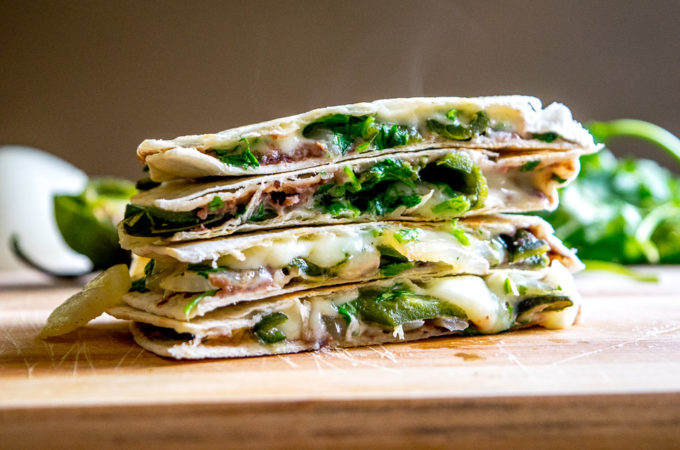 This Roasted Poblano Quesadilla recipe is a great example of the rich, otherworldly flavor that Mexican cuisine can generate by using just a few simple ingredients. And it's served with Avocado Salsa Verde! mexicanplease.com