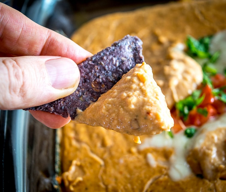 Serve up this Chipotle and Cheese Bean Dip straight from the oven and you'll make some friends for life! Don't forget to add some salsa or roasted tomatoes, it makes a huge difference. So good! mexicanplease.com