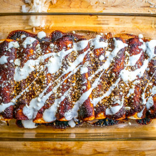 Ancho and New Mexican dried chiles combine with adobo sauce and a sliver of chocolate to create an unbelievably satisfying sauce. Serve it up in classic enchilada style and you've got a dish you can't get anywhere else in your town, or state, or country. Enjoy! mexicanplease.com