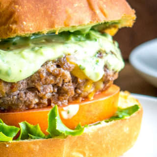 Spicing up your cheeseburgers with chipotles might convert you over for life. And when drenched in a creamy avocado sauce you just made the best burger in town. So good! mexicanplease.com