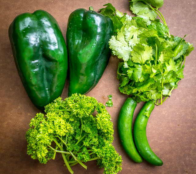 Here's a recipe for a vibrant homemade green chorizo that uses poblanos and serranos to really spice things up. It's surprisingly easy to make too! mexicanplease.com