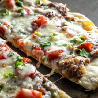 A crispy, thin crust pizza that relies on a delicious black bean puree and a thin layer of garlic oil to create a vegetarian delight. So good! mexicanplease.com