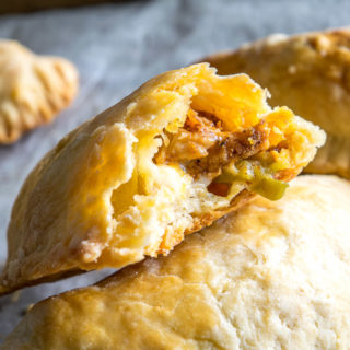 Here's a great combo to consider for your next batch of homemade empanadas: spicy chicken and pickled jalapenos. Don't forget to chill the dough before rolling it out as this will keep them light and flaky. So good! mexicanplease.com