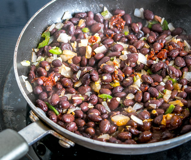 These Black Bean and Rice Cakes are a vegetarian delight with incredible flavor and loads of healthy protein. Drenching them in a Chipotle Crema takes them to another level. So good! mexicanplease.com