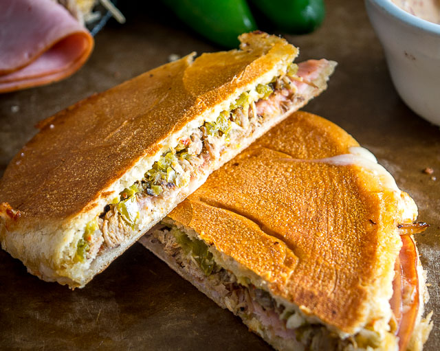 A delicious update on the classic Cuban Sandwich. We are using pickled jalapenos and chipotle mayo in place of the pickles and mustard. Works great with leftover carnitas! mexicanplease.com