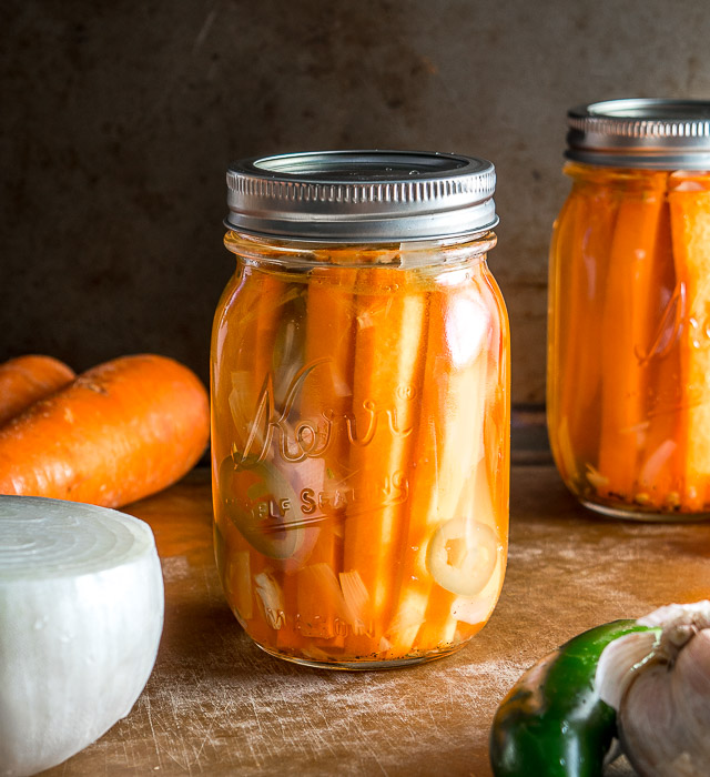 These Mexican Pickled Carrot Sticks want to be in your life! Crispy, delicious, and full of zip from the jalapeno. Super easy to make too. mexicanplease.com