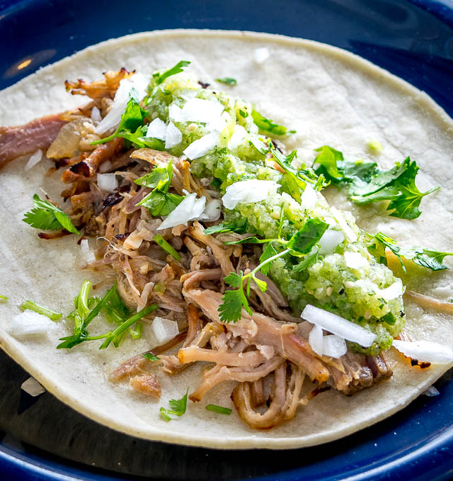 One of my all-time favorite recipes! The slow cooker keeps these carnitas moist and loads them up with flavor. Best combo for tacos is carnitas, salsa verde, onion, cilantro and a squeeze of lime. So good! mexicanplease.com