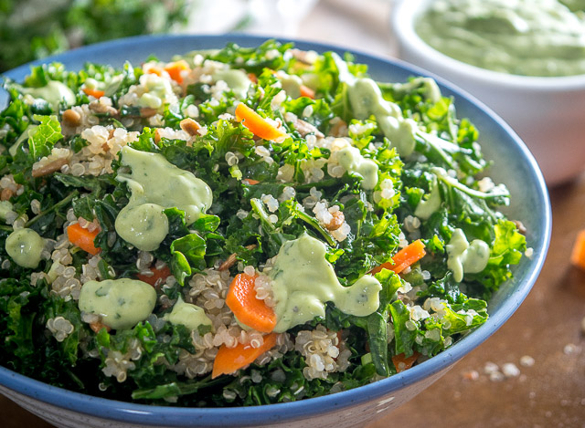 A light, zippy Kale and Quinoa Salad drenched in a yogurt based Creamy Avocado Dressing. As healthy as it gets with loads of flavor. So good! mexicanplease.com