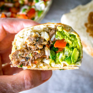 Freshly made Pico de Gallo combines with Barbacoa Beef and Guacamole to make these burritos sing! Slow cooker barbacoa works great but feel free to use any shredded beef you have on hand. So good! mexicanplease.com