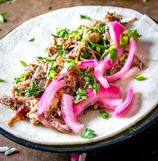 This stress-free slow cooker beef barbacoa can be used in so many delicious ways: tacos, burritos, enchiladas -- you can even serve it over rice for an instant meal. So good! mexicanplease.com