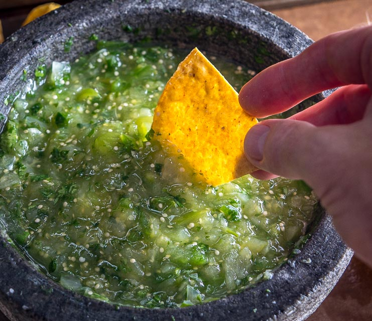 The flavor you can generate by smooshing ingredients in a molcajete is unreal. You'll end up with a vibrant batch of Salsa Verde that could potentially cause you to break up with the other salsas in your life. mexicanplease.com