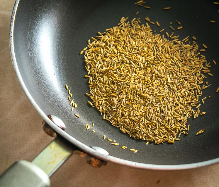 toasting cumin seeds over medium heat