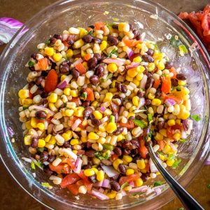 This wildly versatile Black Bean and Corn Salsa will have you dreaming up all sorts of ways to use it: tacos, salads, even wraps! I think it tastes best when the lime flavor is at the forefront so feel to add another squeeze! mexicanplease.com