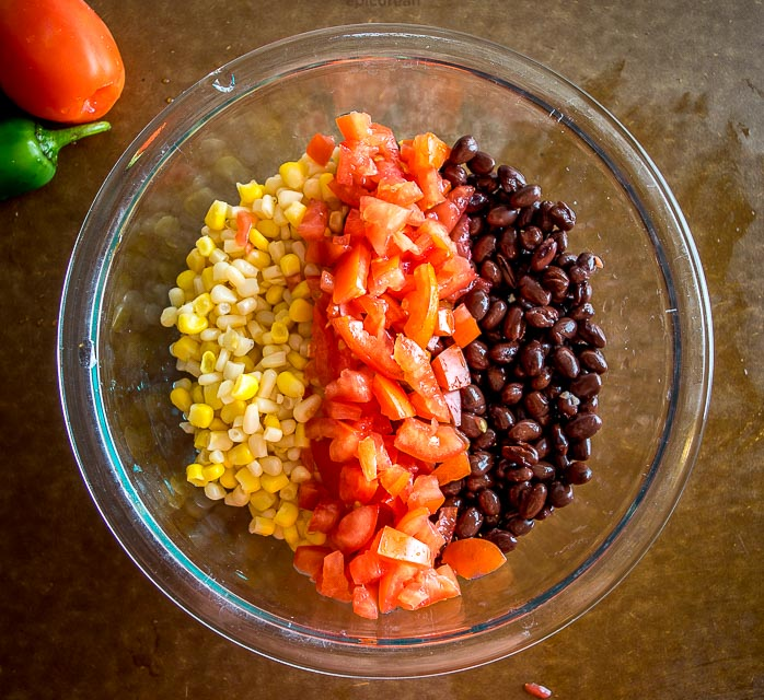This wildly versatile Black Bean and Corn Salsa will have you dreaming up all sorts of ways to use it: tacos, salads, even wraps! I think it tastes best when the lime flavor is at the forefront so feel free to add another squeeze! mexicanplease.com