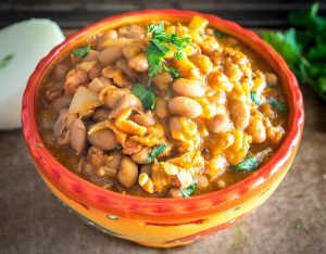 Charro Beans! You won't find a heartier, more delicious batch of beans anywhere in Mexico. This version uses bacon and chipotles but feel free to add in some chorizo if you have it. So good! mexicanplease.com