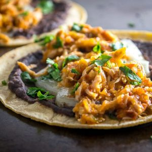 This is a delicious, fiery version of Chicken Tinga. The key is to use both tomatoes and tomatillos, along with plenty of chipotles! mexicanplease.com