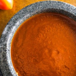 Here's a simple recipe for a fiery, concentrated batch of Salsa Roja. We use this as a topper sauce for tacos, grilled meats, and even eggs! mexicanplease.com