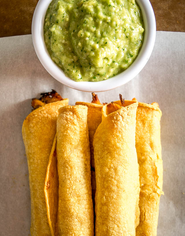 A few simple tricks will ensure you end up with a crispy batch of Chicken Flautas. We're serving them with a fiery Avocado Salsa Verde. So good! mexicanplease.com