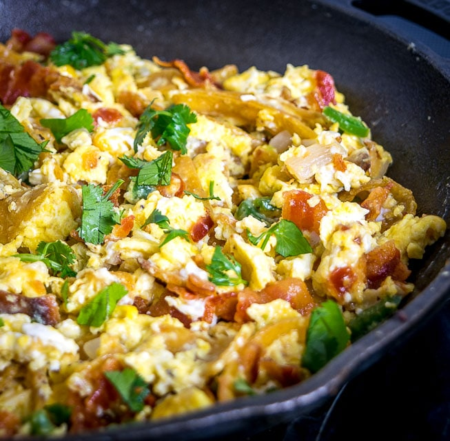 Migas are the perfect Mexican breakfast dish for lazy weekend mornings. We're topping this version with a freshly made Salsa Verde and it is delicious! mexicanplease.com