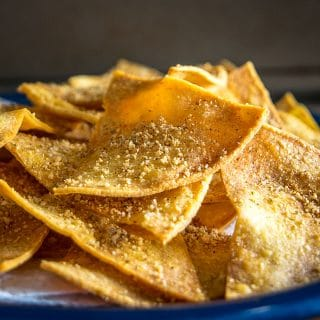 This is the easiest way to make a batch of Baked Tortilla Chips. I like them best when the edges are crispy but the middle is still slightly chewy, i.e. don't cook them too long! mexicanplease.com