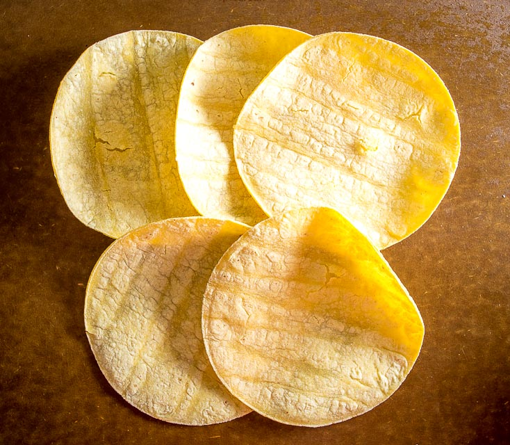 This is the easiest way to make an awesome batch of Baked Tortilla Chips. I like them best when the edges are crispy but the middle is still slightly chewy, i.e. don't cook them too long! mexicanplease.com