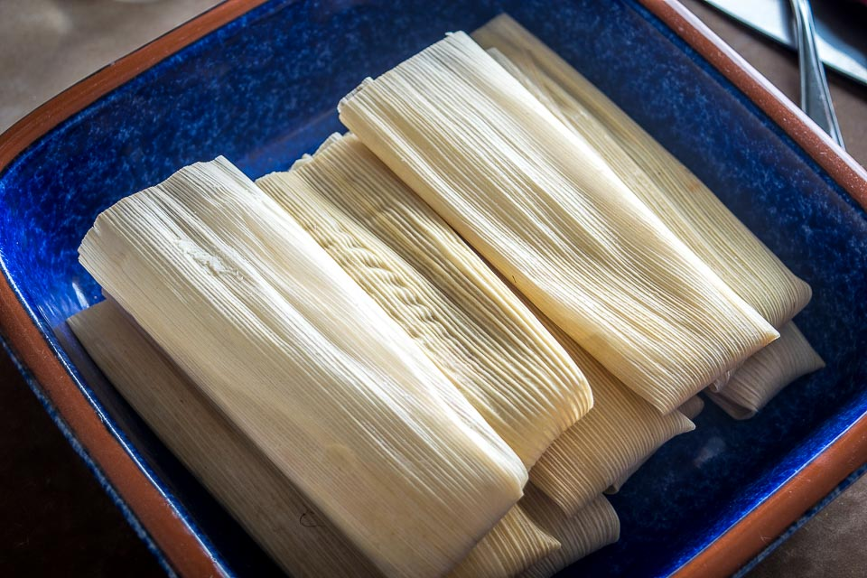 Here's an easy tamales recipe to keep in mind for weeknight dinners. Using leftovers for the tamale filling really simplifies the process -- we're using leftover bean dip in this batch! mexicanplease.com