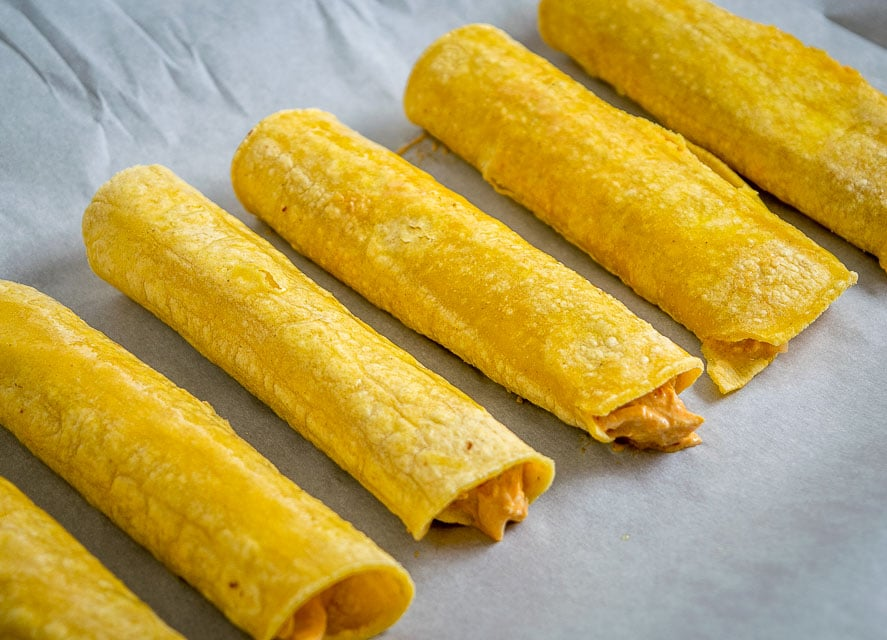 Adding cream cheese to your taquitos is a massively rewarding shortcut to take! We're also using some Tomatillo Chipotle Salsa in this batch -- so good! mexicanplease.com