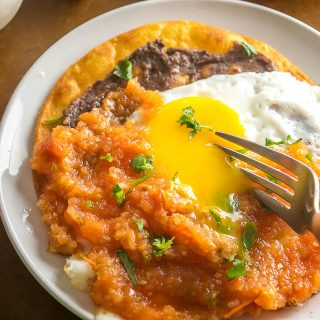 If you have some homemade Salsa on hand then you don't need much else for an authentic batch of Huevos Rancheros. We're adding some freshly made refried beans to this batch -- so good! mexicanplease.com