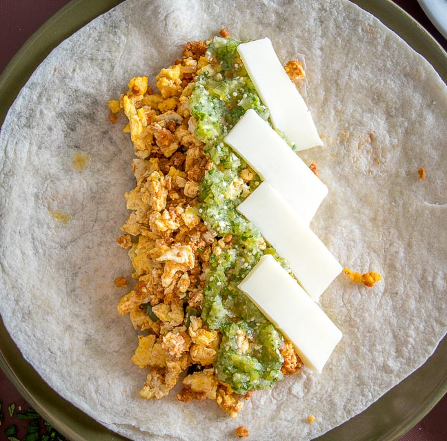 making breakfast burritos with chorizo egg leftovers