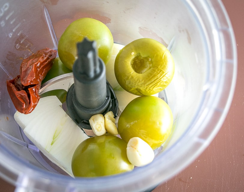 add salsa ingredients to the blender