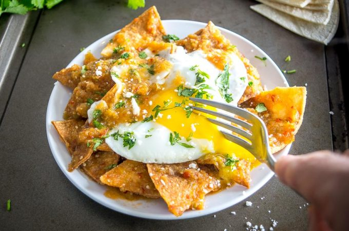 chilaquiles served with egg on a plate