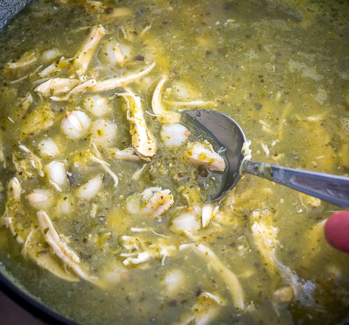 Adding more hominy to Pozole Verde