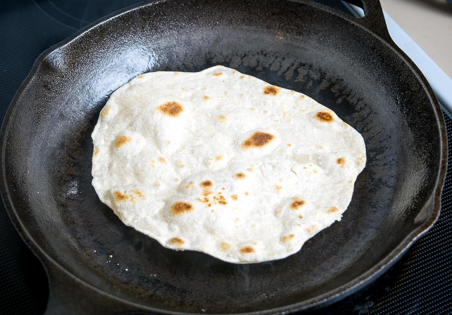 Light brown spots on homemade flour tortilla.
