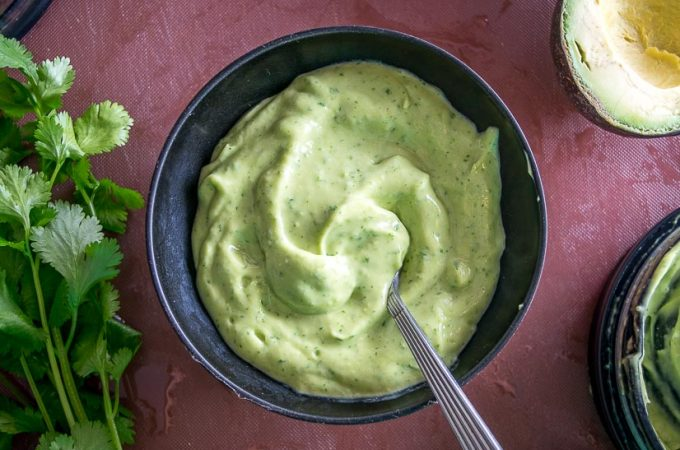 Avocado Salsa being served at the table.