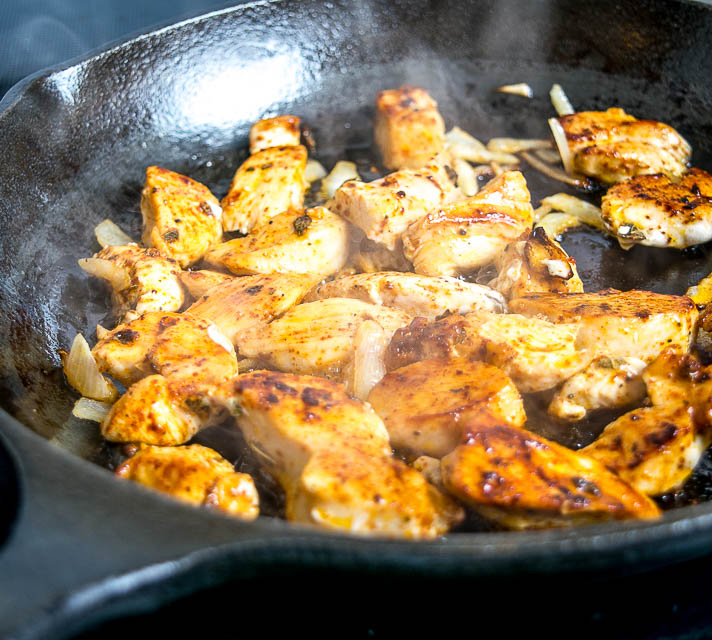 Saute chicken pieces in cast iron skillet.