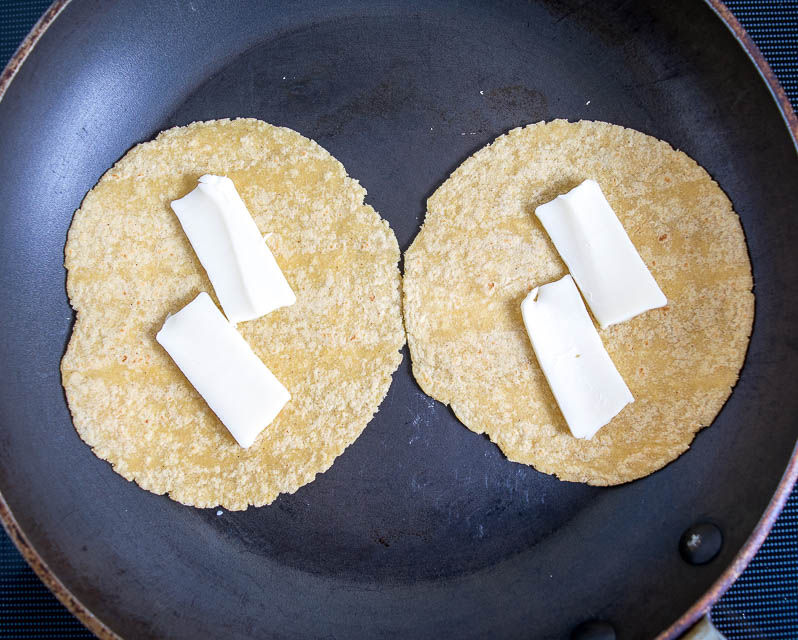 Melting cheese in tortillas in a dry skillet.