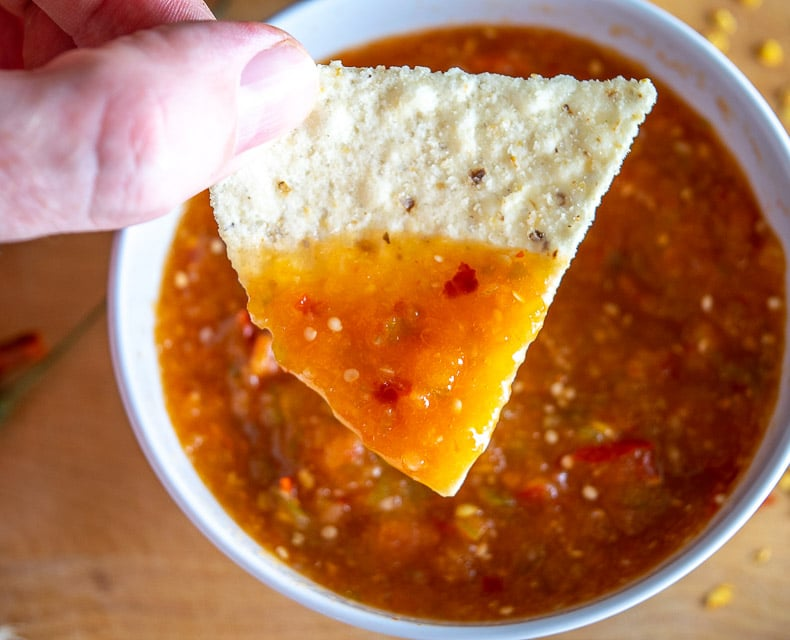 Dipping a chip in Chile de Arbol Salsa