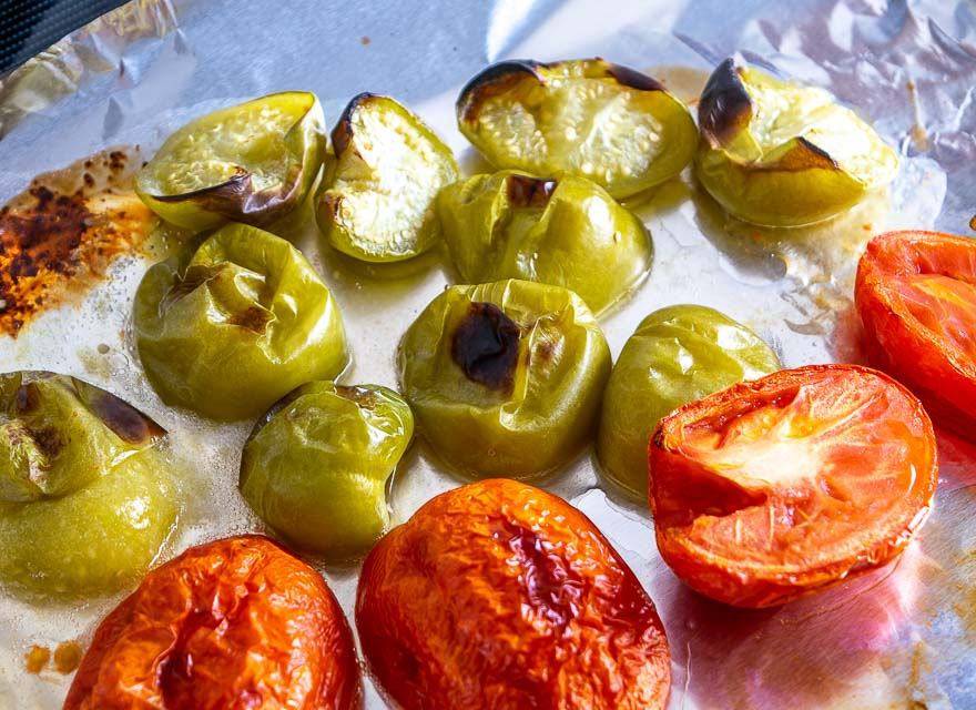 Tomatoes and tomatillos after roasting for 15 minutes