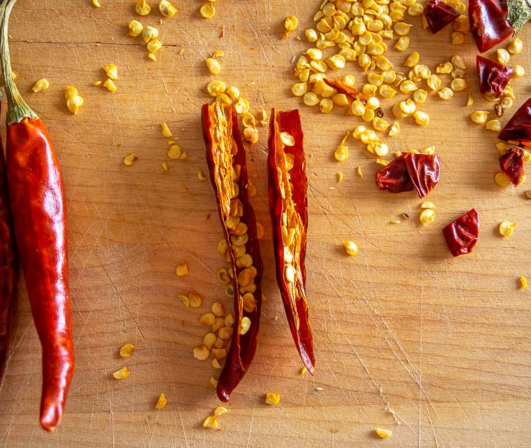 De-stemming and de-seeding Chile de Arbol chiles